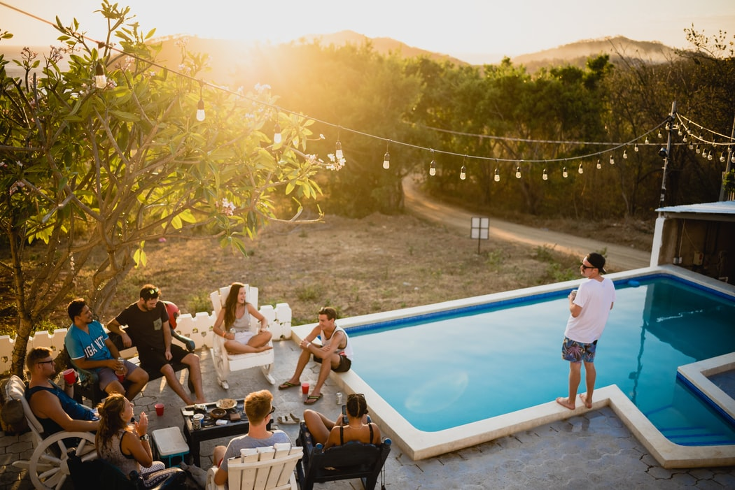 people sitting together near pool