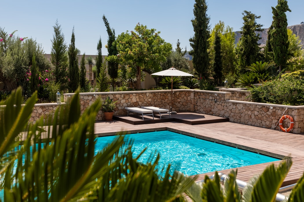 stone backyard with pool