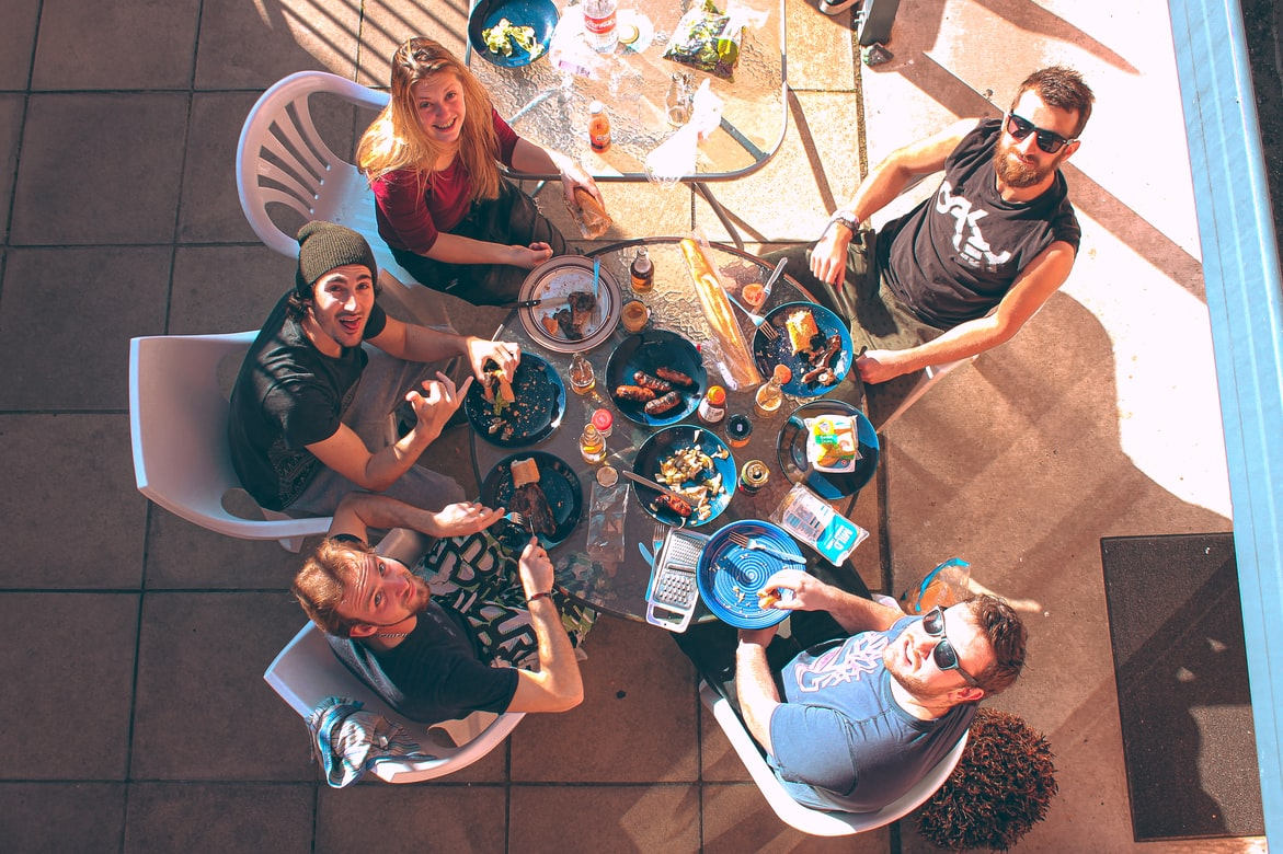 people sitting around table outside